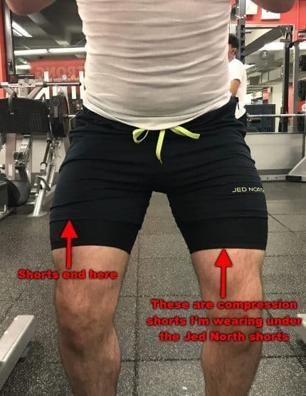 Squatting in Jed North Fitted Lifting Shorts - Front View - Concentric Rep