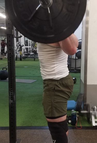 Squatting in Young LA Lifting Shorts - Side View - Top of Squat