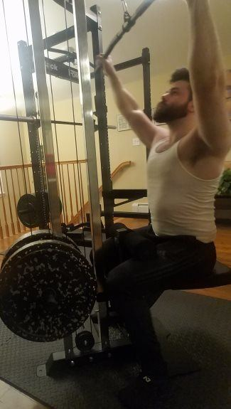 Force USA MyRack Doing Lat Pulldowns on Cable Crossover Attachment