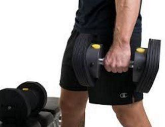 Guy Holding MX55 Dumbbell at Side