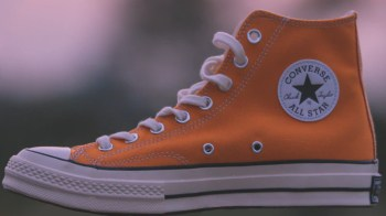 Orange Chuck Taylor high tops