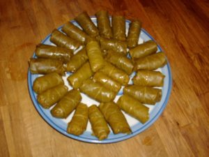 Stuffed Grape Leaves ready to go into a pan of homemade turkey broth.
