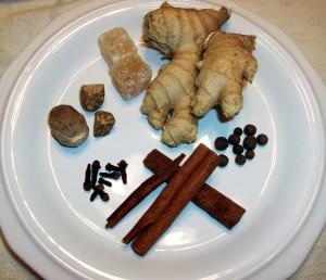 Clockwise from the bottom: Cinnamon, Cloves, Nutmeg, Ginger, Allspice