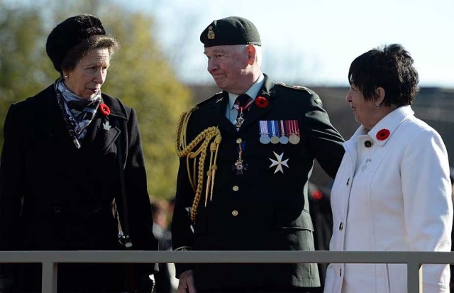 PHOTO: Sean Kilpatrick, The Canadian Press Governor General David Johnson talks with Princess Anne and Silver Cross Mother Gisele Michaud as they wait to inspect the parade during Remembrance Day ceremonies at the National War Memorial in Ottawa on Tuesday, November 11, 2014.