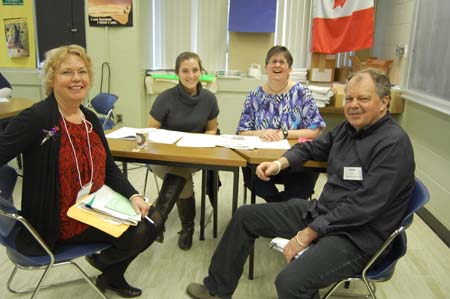 <em>Jamie Swift and Judi Wyatt (at far right and far left) have been involved in the Kingston peace and disarmament movement for many years. They are pictured here working with fellow volunteers at the Poverty Challenge in 2012.</em>
