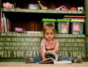 4' x 4' bookcase with Bob Dylan's lyrics to forever young painted on.