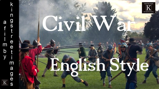 Group of English Civil War re-enactors charge and fight with pikes as the sun goes down.