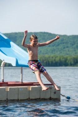 free time waterfront lake fun slide happy camper
