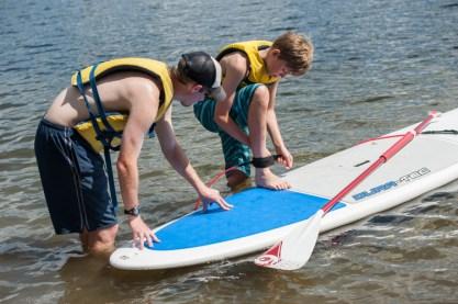 paddleboarding clinic waterfront lake new hampshire boys sleepaway summer camp new england