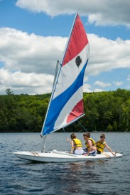 boys sailing in the lake