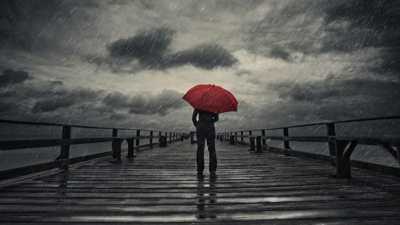 Red umbrella in storm