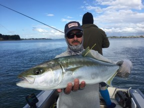 Salt water fly guide Lucas Allen with a tagged kingfish ready for release.