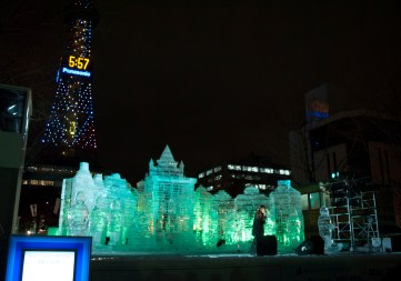 Sculpture road concert stage with Sapporo Tower in the background.