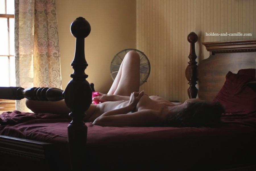 Woman laying on bed masturbation