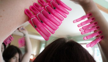 Pink clothespegs along arms