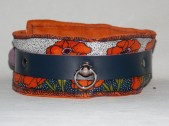 "There are only four of these collars available. Perfect for Wizard of Oz enthusiasts. -- ""Poppies will put them to sleep!"""