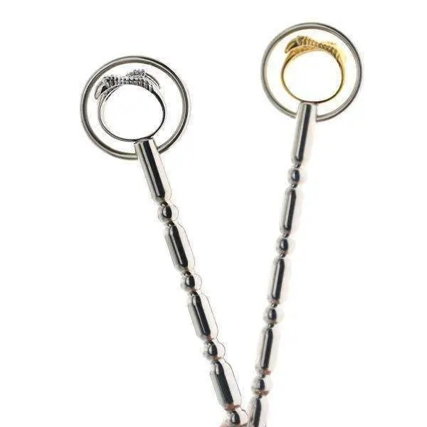 Urethral penis plug and urethral sound dilator with claws