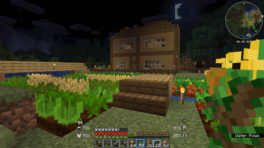 A night time photo of the almost completed house. I've attempted to build a roof out of logs too.
