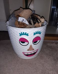 White bin with face stickers in a flirty gesture