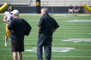 Coach Ferentz and Coach Morgan share a laugh after a big hit that reverberated through the crowd