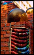 One of my favourite pictures. It shows the contrast of the urban construction against the traditional colours of bangles. Another installation which depicts co-existence.