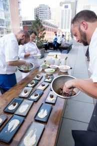 chefs paling food at event, event catering staff event photographer, chefs at event, executive chef, paling lunch for group