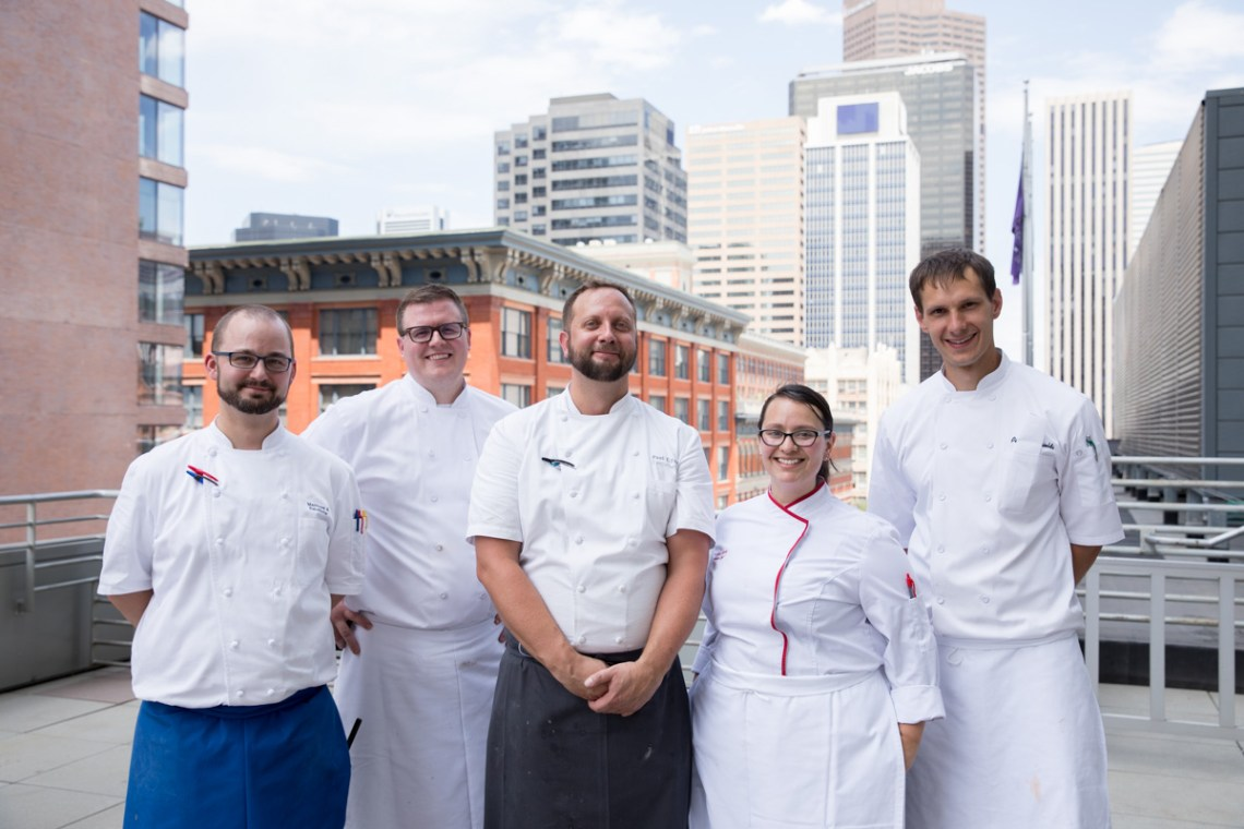 Executive chef team at Hyatt regency Denver at Colorado convention center, group portrait of chef team, chefs at catering event, 5 chefs on rooftop, event photographer Denver, Denver conference photographer at event, chefs paling food at event, event catering staff event photographer, chefs at event, executive chef, paling lunch for group, Colorado Convention center, Denver Big Blue Bear, CCC, Big Blue bear, event food prep, event photographer