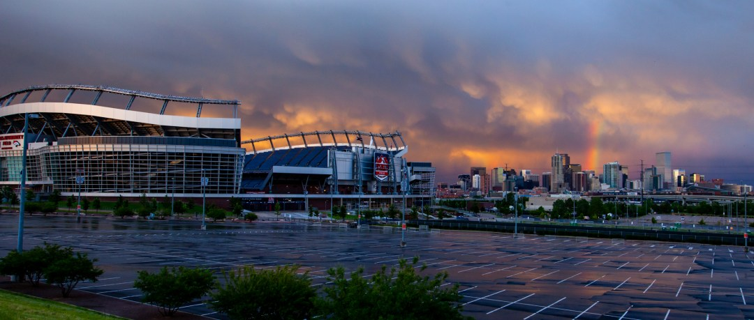 Kinser Studios event photographer photographs Mile High Stadium with Rainbow, Laura Kinser