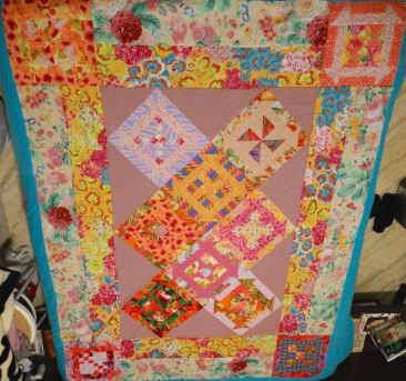 Eleni Sarantoglou from Greece, Year 1 Completed Intermediate Top from Kinship Quilters in Pink Colorway