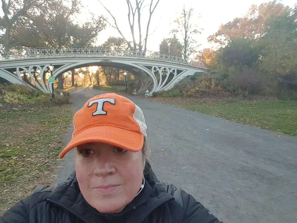 Strolling in Central Park by bridge no. 28 aka Gothic Bridge listening to a top podcast