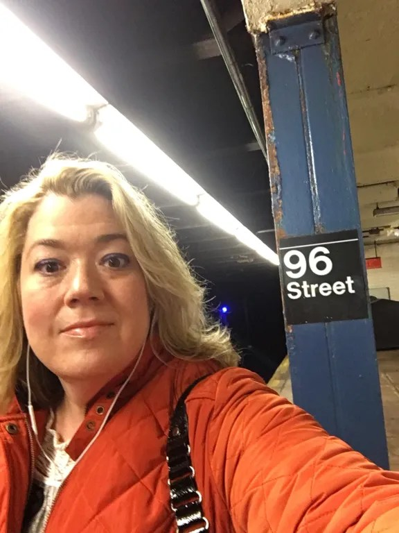 Waiting for the B train to work in midtown West., listening to a Pod