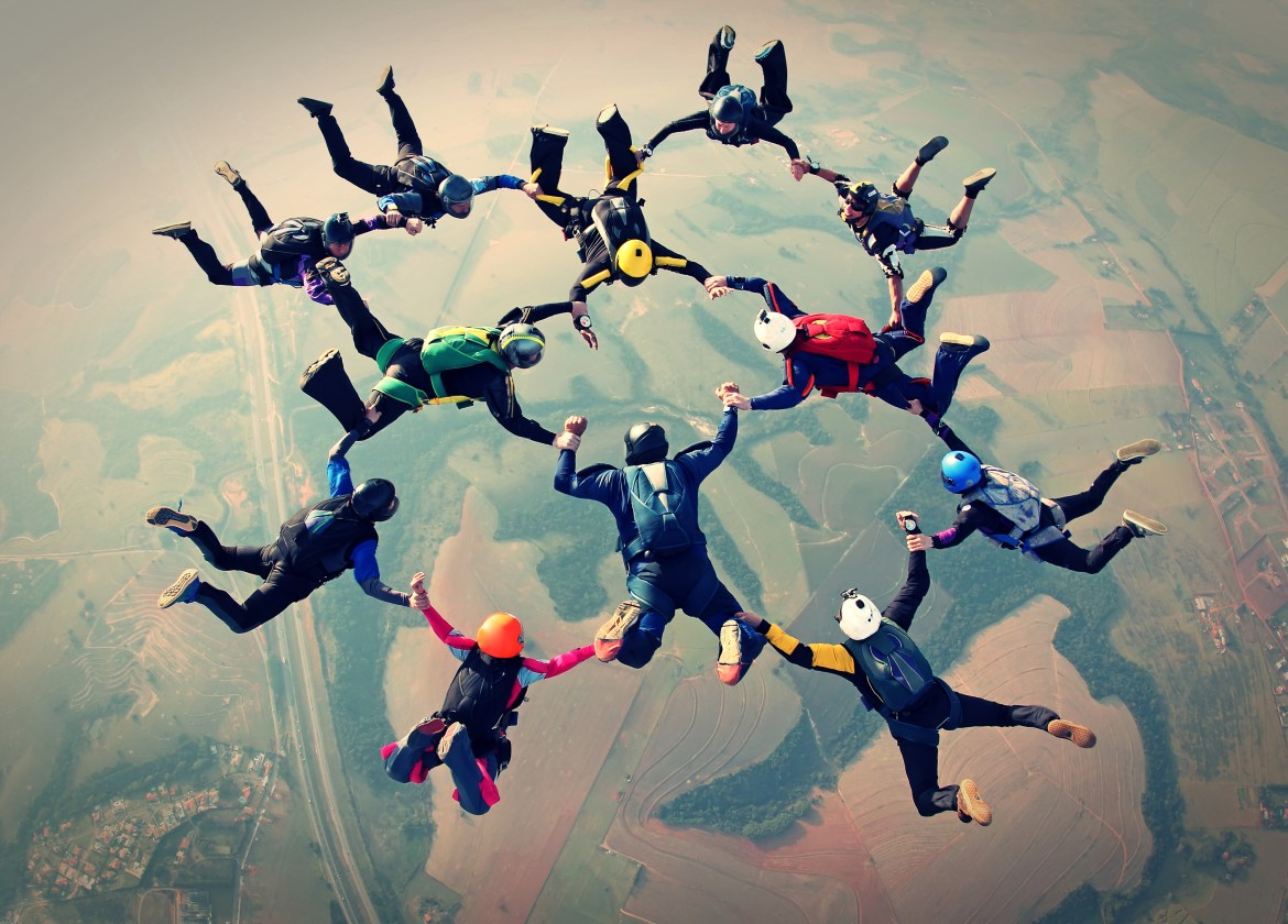 Skydivers controlling a group configuration