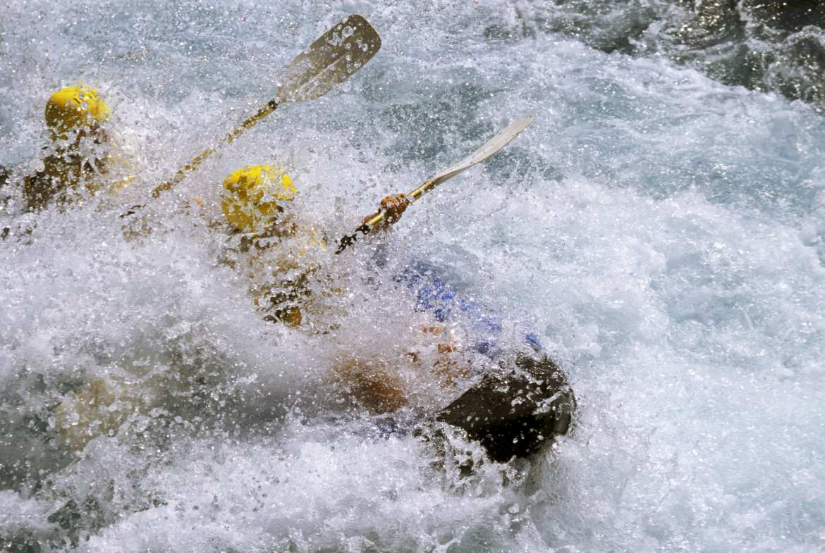 People white water rafting with little visibility