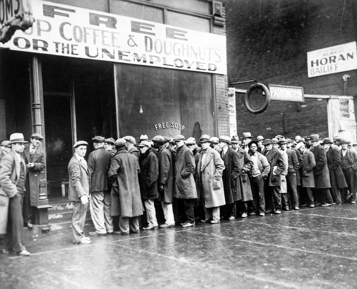 crowd of unemployed people standing outside a business during the Great Depression