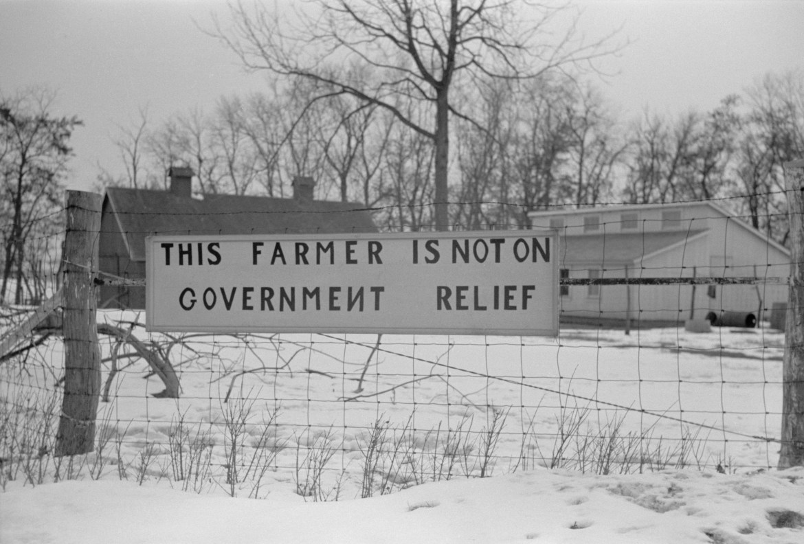 "photograph of a farm with a sign saying, ""This farmer is not on government relief."""