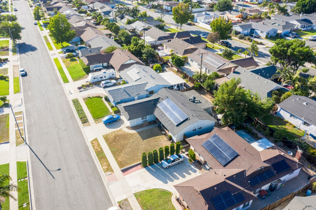 neighborhood in California with multiple houses with solar panels