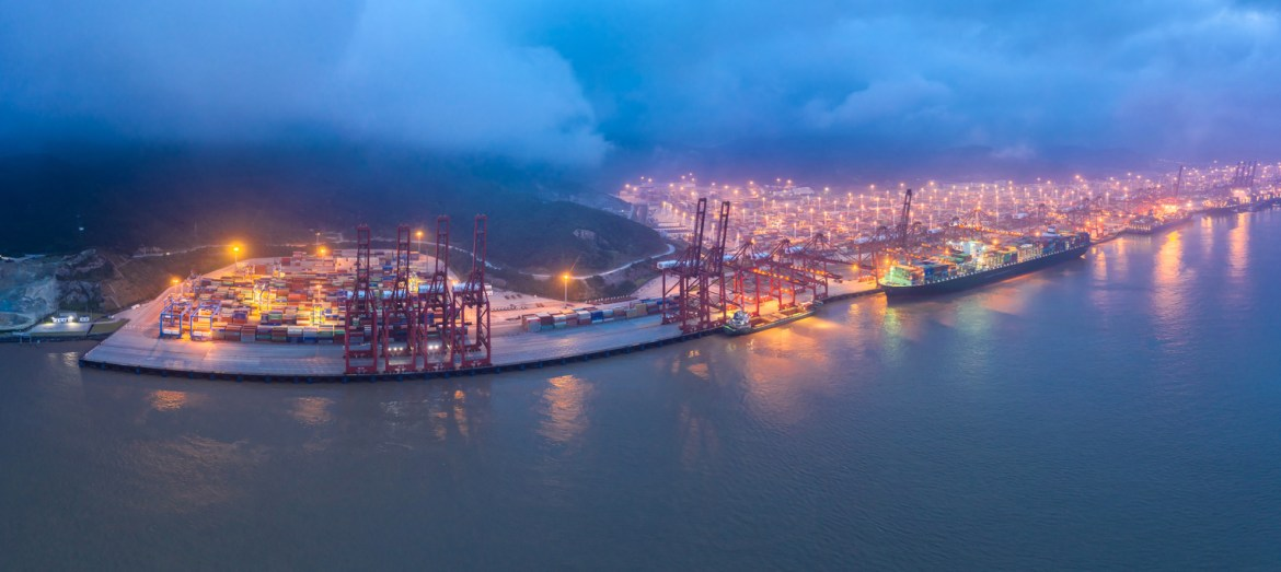 A container ship in a Shanghai port at night