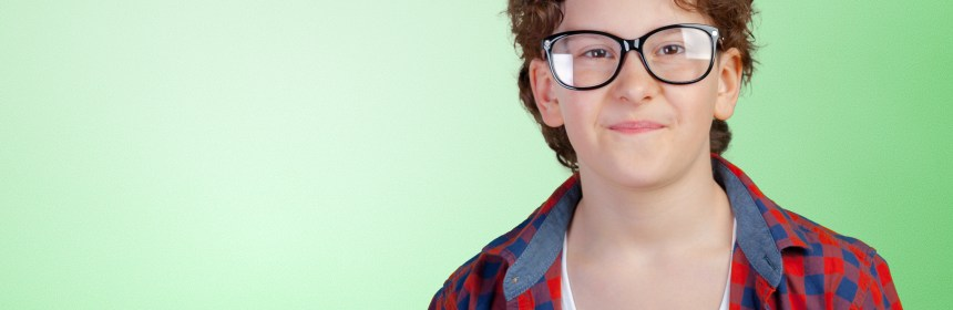 Portrait of young boy wearing glasses