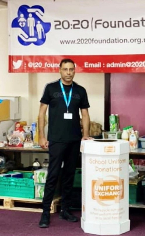 Photo: Former Mayor Cllr. Hussain volunteering at his local foodbank.