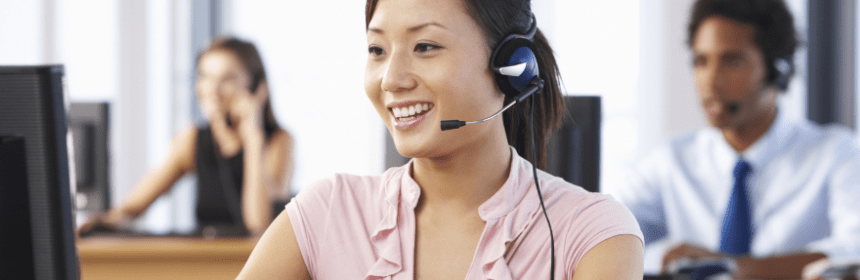 Woman speaking with a headphone set on
