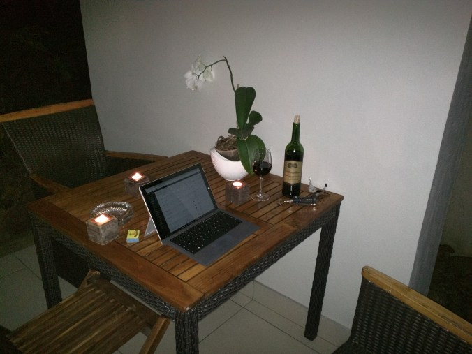It's a hard life writing by candlelight with wine on my patio.