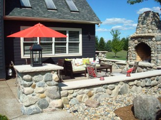8-Sylvania-outdoorgranite boulder fireplace-stone wall-accent lighting-posts-limestone caps