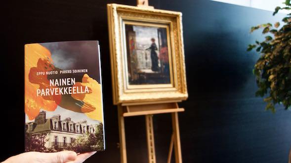 Taustalla Albert Edelfeltin luonnos maalaukseen Nainen parvekkeella.