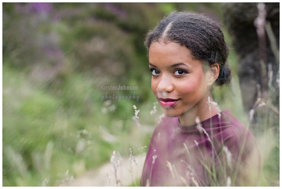 Teenage girl sitting in tall grass