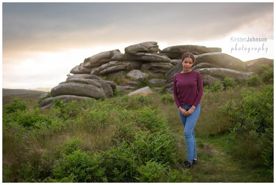 Teenage girl standing by rocks