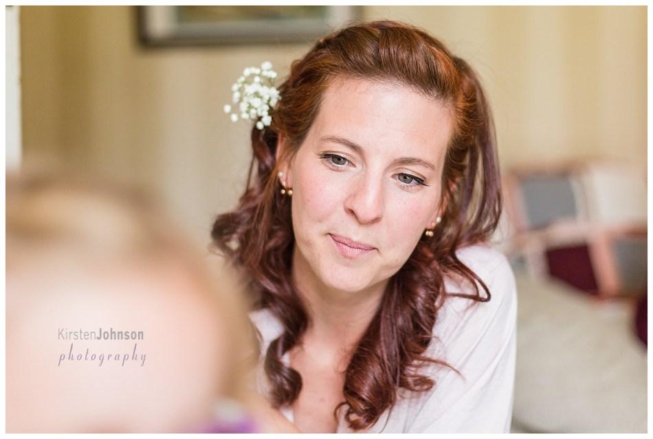 Bridesmaid looking at daughter