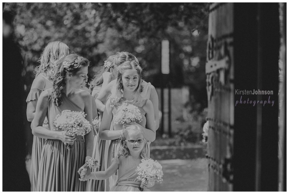 bridesmaids waiting at door of church