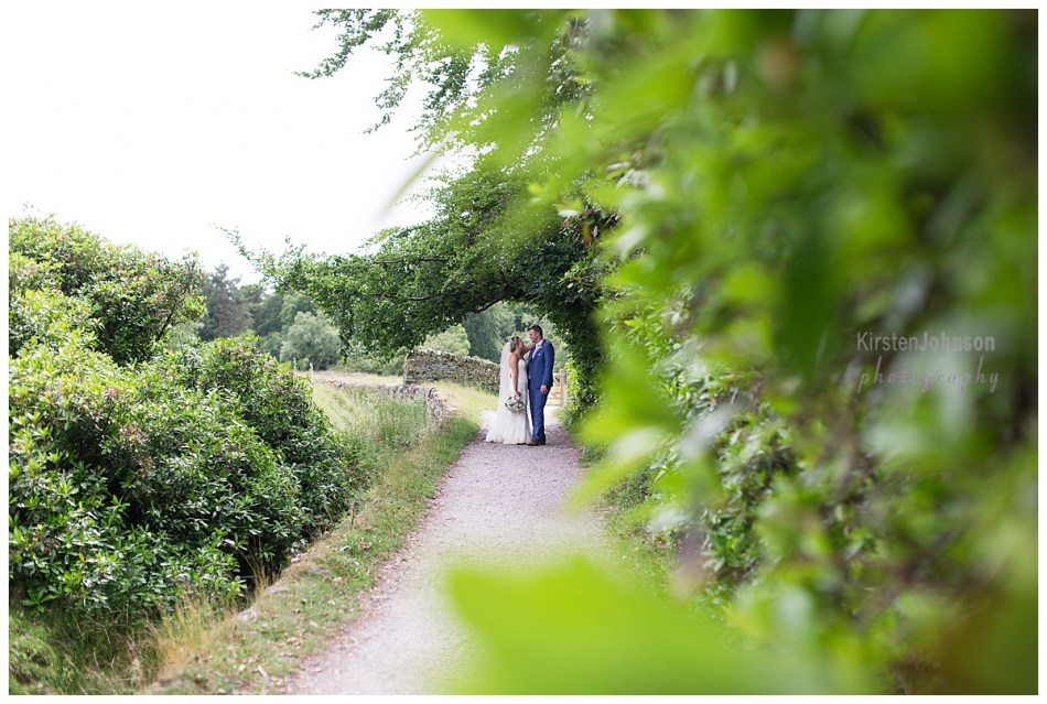 bride and groom on path in peak district