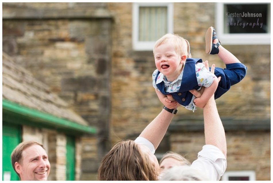 boy being lifted in air