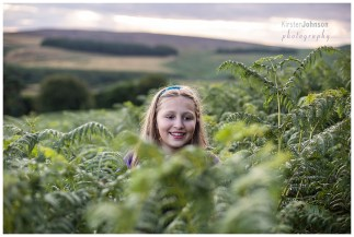 young girl in the ferns at Stannage Edge